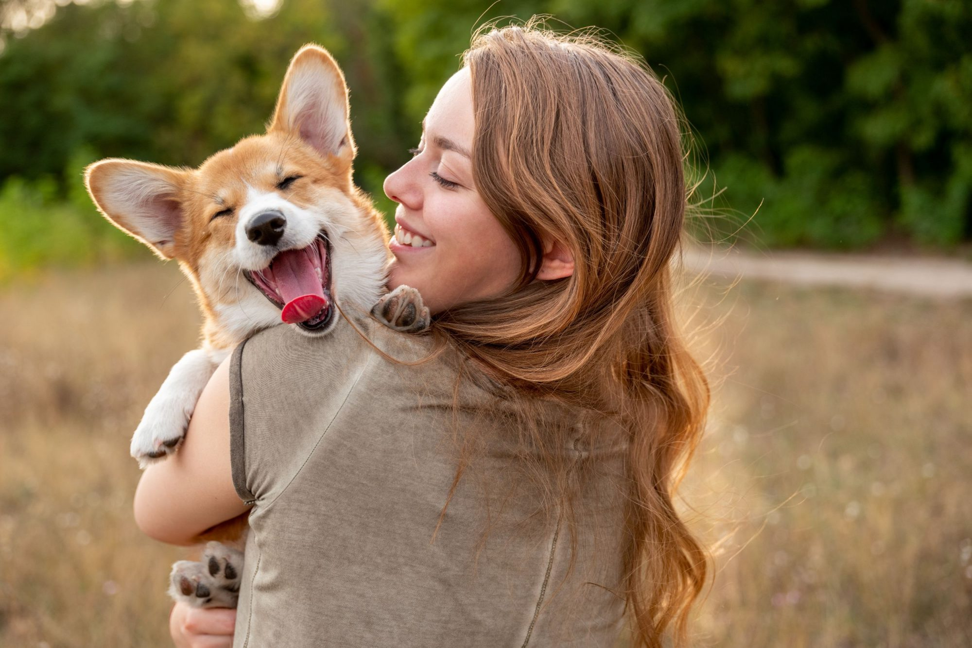 Woman holding puppy in her arms.